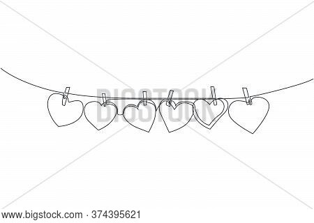 One Continuous Line Drawing Of Cute Heart Shape Paper Hanged On The Rope With Clothesline. Romantic
