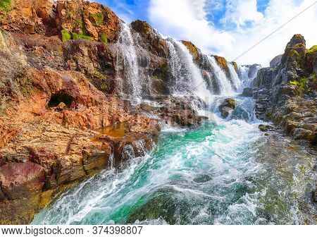 Captivating View Of  Kolufossar Waterfall At Summer Sunny Day.  Popular Tourist Travel Destination I