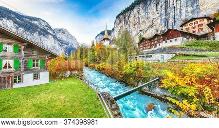 Stunning Autumn View Of Lauterbrunnen Village With Awesome Waterfall  Staubbach  And Swiss Alps In T