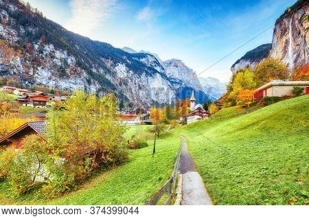 Captivating Autumn View Of Lauterbrunnen Valley With Gorgeous Staubbach Waterfall And Swiss Alps In
