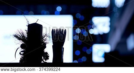 Contour Of A Large Candle And A Full Stand For Napkins Against The Background Of The White Screen An