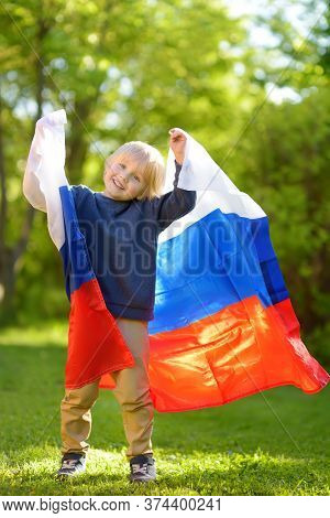 Portrait Of Cute Little Boy In Public Summer Park With Russian Flag On Background. Fans Child Suppor