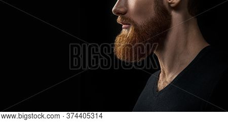 Dramatic Concept Beard Close-up Photo. Portrait Of Young Handsome Bearded Man Looking Forward. Studi