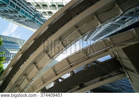 Low Angle Photo Under Railroad Tram Tracks In The City