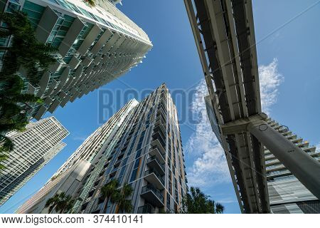 Low Angle View Highrise Towers And Tram Tracks