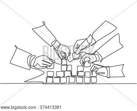Single Continuous Line Drawing Of Business Team Member Arrange Wooden Cube Block Become Sturdy Tower