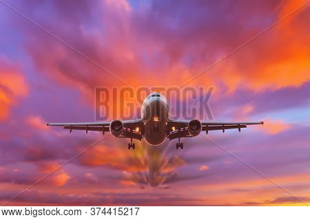 Evening Beautiful Bright Sky At Sunset With A Flying Passenger Plane