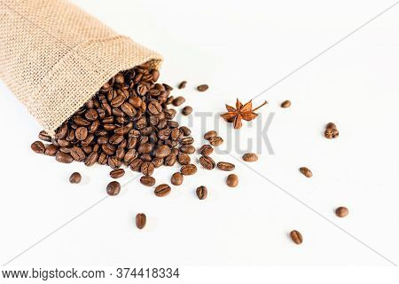 A Burlap Bag With Coffee Beans On A White, Scuffed Background. Concept Of A Popular Invigorating Dri