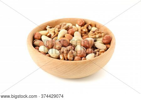 Bowl With Different Nuts Isolated On White Background. Vitamin Food