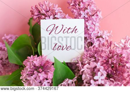 Inscription With Love On A White Gift Card In A Beautiful Bouquet Of Lilac Flowers