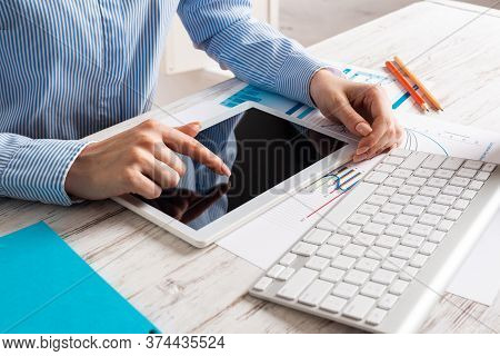 Manager Using Tablet Computer With Blank Screen. Close Up Woman Hand Pointing On Touchscreen. Strate