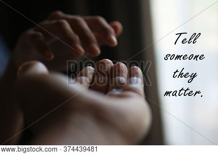 Inspirational Quote - Tell Someone They Matter. With Two Hands Closeup Showing Kindness, Love And Ca