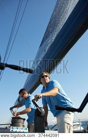 Two male sailors on yacht