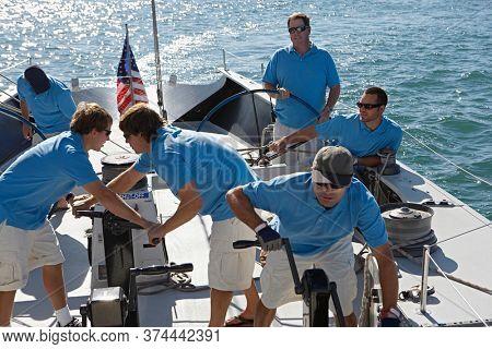 Male sailing team on yacht