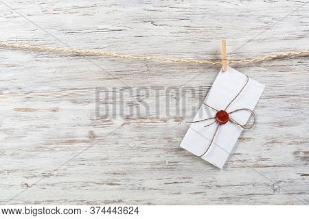 White Classic Envelope Hanging On Twine Rope With Clothespins. Vintage Declaration Of Love On Wooden