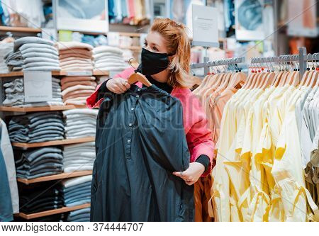 Beautiful Woman With Phone Bright Pink Shopping Mall Coat With Black Protective Mask On Her Face Fro