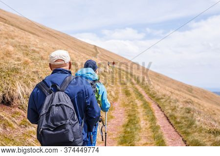 Senior People Hiking In Nature. Traveling In Nature. People Hiking In Mountain. People Hiking Outdoo