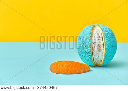 Peeled Lobule Peel Of An Orange Painted In Turquoise Color. Creative Design Concept