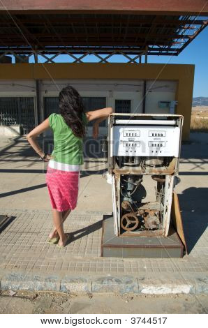 Woman And Old Gas Pump