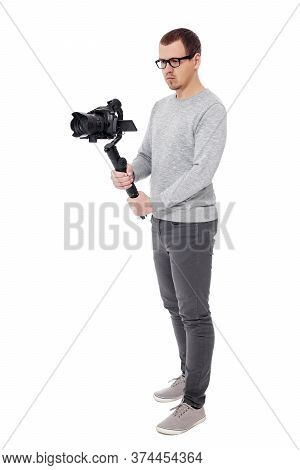 Full Length Portrait Of Professional Videographer With Dslr Camera On 3-axis Gimbal Isolated On Whit