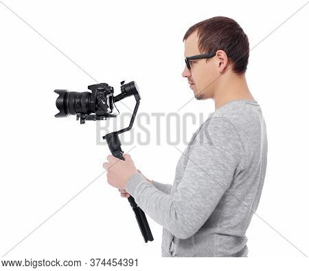 Side View Of Professional Videographer Using Dslr Camera On Gimbal Stabilizer Isolated On White Back
