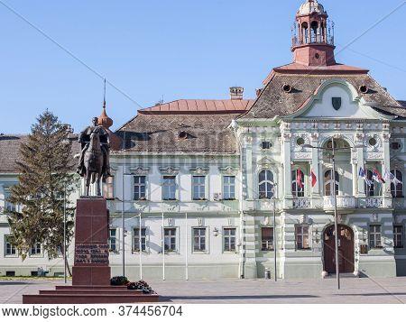 Zrenjanin, Serbia - November 23, 2019: Main Square With The King Kralj Petar I Statue And The City H