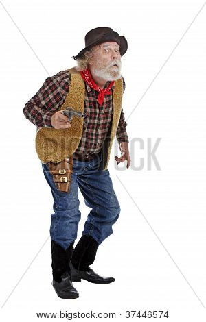 Old Cowboy Holding Gun Looks Fearful