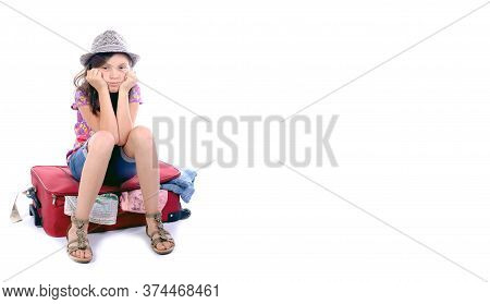 Preteen Girl Sitting On A Suitcase Isolated On The White Background