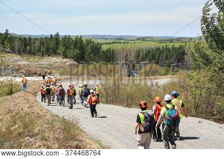 Sudbury, Ontario, Canada - May 21 2009: Group Of Workers And Geologists In Hardhats And High-visibil