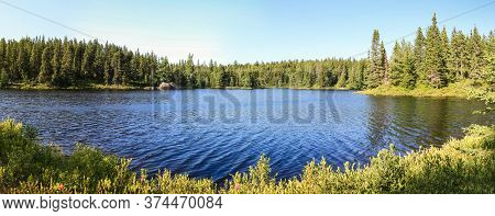 Idyllic Blue Lake And Forest Landscape In Evening Sunset Sunlight. Sudbury, Ontario, Canada.
