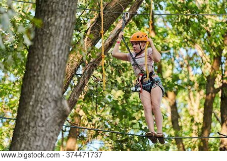 Voronezh, Russia, 23.08.2019 - Girl In High Ropes Experience Adventure Tree Park. Rope Road Course I
