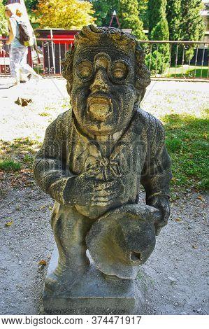 Salzburg, Austria, 09,03,2011. Statue Of A Dwarf From The Garden Of The Dwarfs Of Mirabel Park.dwarf