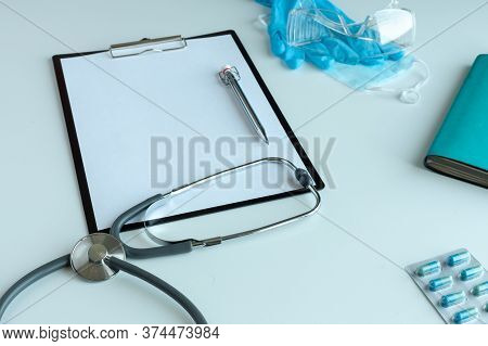 Doctor General Practitioner Desk. Healthcare Insurance Concept. Table Top View Essential Doctors Equ