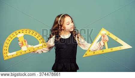Pupil Girl With Big Rulers. School Student Learning Geometry. Small Girl Back To School. Stem School