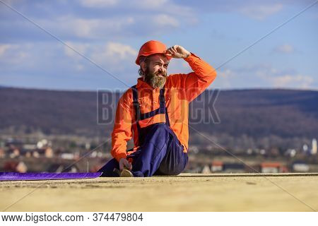 Man Roofing Surface. Estimate Materials Requirements For Projects. Install Roofing Materials. Heat I