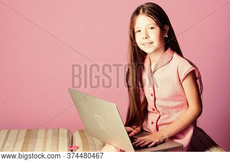Online Courses Education. Small Girl Pupil With Laptop. Child Study Online. E Learning At Private Le