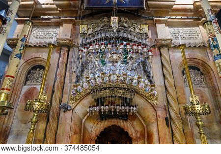 Jerusalem, Israel, June 13, 2020 : Icons And Lamps Over The Entrance To Kuvuklia In The Holy Sepulch
