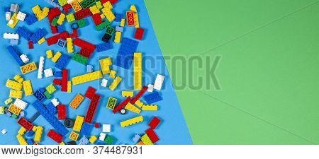 Vilnius, Lithuania - February 23, 2019. Colorful Lego Blocks On Light Blue And Green Blackground. To