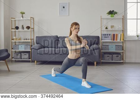 Stay Home Workout. Sporty Girl Exercising Indoors, Doing Yoga, Pilates Or Cardio Training. Active Li