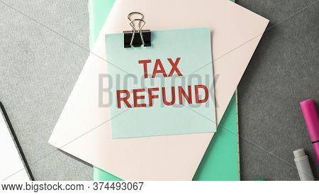 Notebook With A Business Notes Tax Refund On The Office Table With Tools. Concept Tax Refund With El
