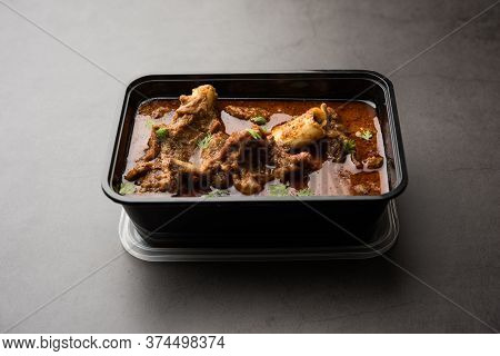 Mutton Masala Curry In Plastic Container For Home Delivery