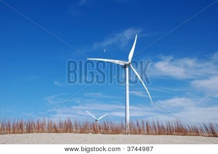 Green Energy Windmill Turbine In The Blue