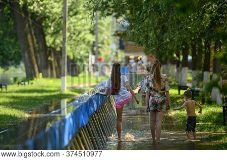 Vadul lui Voda, Criuleni, Moldova, June 2020: People play with water leaked through barriers set to prevent flood caused by Dniester river spill after heavy rains in Vadul lui Voda beach area