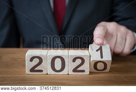A Close Up Of A Businessman Looking Ahead To The Future With Confidence And Changing The Date Of A C