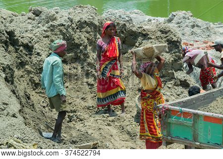 Howrah, West Bengal, India - 7th May 2017 : Indian Hard Working Female Workers Digging And Carrying