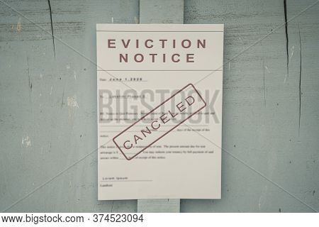 Canceled Foreclosed Or Eviciton Notice On A Main Door With Blurred Details Of A House With Vintage F
