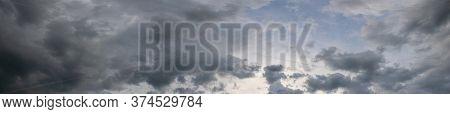Panorama Of Dark Gray Stormy Sky, Gray Clouds Cover The Sky