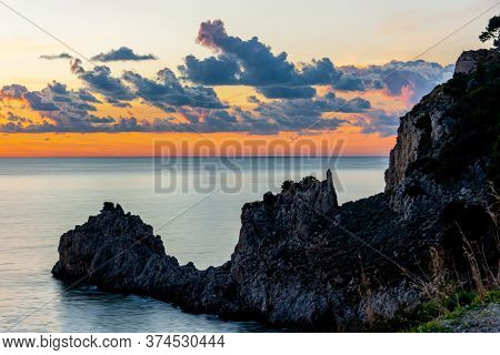 Rocky Coast Of Riviera Of Ulysses At Sunset, Cloudy Red Sky On Background. Sperlonga Italy. High Qua