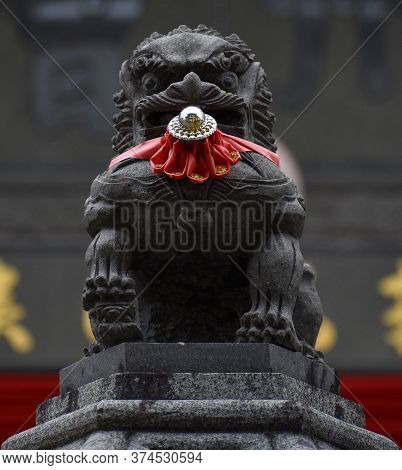 Stone Carved Gate Guardian Lion Outside A Chinese Temple