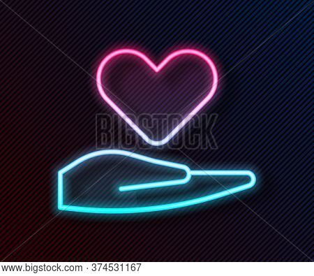 Glowing Neon Line Heart On Hand Icon Isolated On Black Background. Hand Giving Love Symbol. Valentin